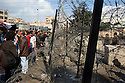 Egyptian anti-government protesters shout appeals for Egyptian soldiers to join with the people across a barbed wire barricade outside the heavily guarded Orouba Presidential Palace February 11, 2011 in the Heliopolis district of Cairo, Egypt. Protesters marched Friday on a number of public buildings including the palace in an effort to spread their ongoing protests that are now in their 18th day. (Photo by Scott Nelson)
