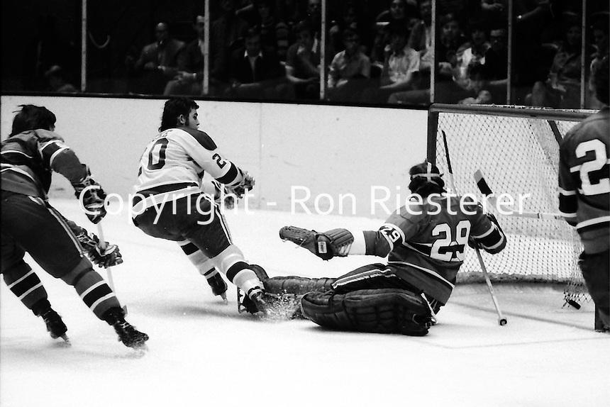 Seals vs Canadiens...Ernie Hicke scores for the Seals against goalie Ken Dryden. (1971 photo/Ron Riesterer)