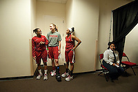 FRESNO, CA--Teammates Alex Green, Mikaela Ruef and Jasmine Camp share a laugh while watching teammates warm up at the Save Mart Center for the 2012 NCAA Championships.