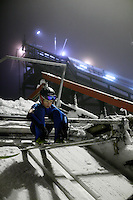 Halvor Egner Granerud concentrating before setting off down the K39 ski jump in Linderudkollen ski jumping arena. The larger 70 meter jump in the background.