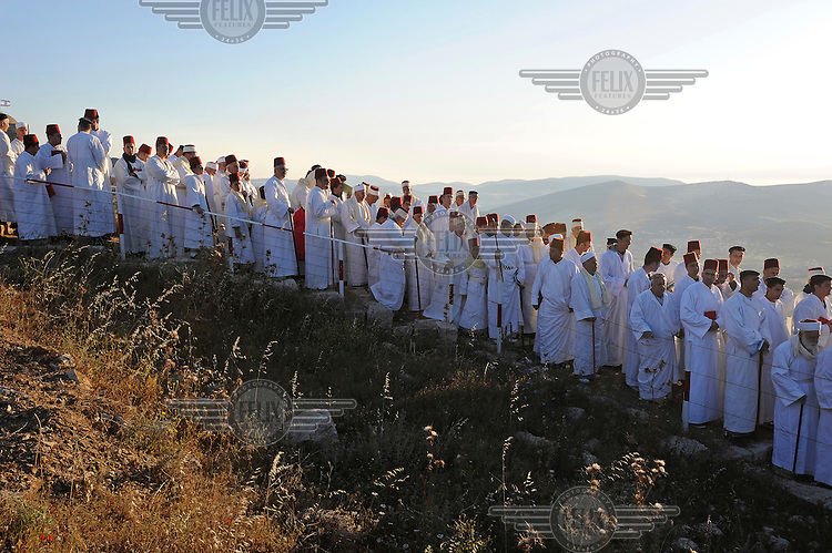 Samaritan men gather to say Passover prayers on the summit of Mount Gerizim, above the town of Nablus, the religion's most holy site.