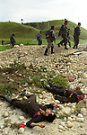 Soldiers march past dead rebels killed by government troops in Hato Corozal, about 150 miles northeast of Bogota. The army ambushed two truckloads of rebels, killing at least 24 fighters from the leftist Revolutionary Armed Forces of Colombia, FARC, who had attacked a police station in the area just days before. (Photo/Scott Dalton)