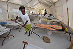 Sonia Noel, a health worker for Oganizasyon Sante Popilè (OSAPO), mops the floor of a cholera treatment center in Montrouis, Haiti. Cholera appeared on the quake-ravaged Caribbean island nation in late 2010. OSAPO's work is supported by Diakonie Katastrophenhilfe and the Lutheran World Federation, both members of the ACT Alliance. In addition to treating people infected with cholera, OSAPO sends teams of health educators into urban and rural communities to provide education, distribute anti-bacterial soap and oral rehydration salts, and refer sick patients back to the OSAPO clinic...