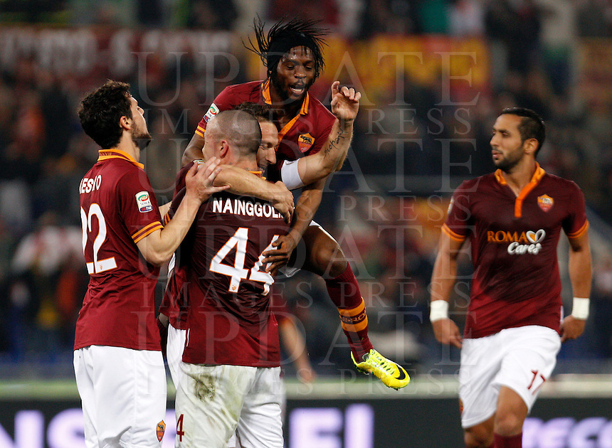 Calcio, Serie A: Roma vs Udinese. Roma, stadio Olimpico, 17 marzo 2014.<br /> AS Roma forward Francesco Totti, center, celebrates with teammates after scoring during the Italian Serie A football match between AS Roma and Udinese at Rome's Olympic stadium, 17 March 2014.<br /> UPDATE IMAGES PRESS/Riccardo De Luca