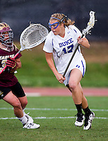 Morgan Miller (17) of Duke makes her way past Sheila Serafino (33) of Boston College during the first round of the ACC Women's Lacrosse Championship in College Park, MD.  Duke defeated Boston College, 17-6.
