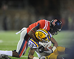 LSU wide receiver Odell Beckham Jr. (33) is tackled by Mississippi's Wesley Pendleton (6) at Vaught-Hemingway Stadium in Oxford, Miss. on Saturday, November 19, 2011.