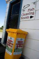 Rom for rensing av fisk og tank for desinfisering av fiskeutstyr på campingplass i Turangi ---- Fish cleaning room and tank for cleaning of fishing gear in camp in Turangi