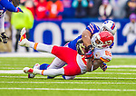 9 November 2014: Kansas City Chiefs wide receiver Dwayne Bowe is tackled by Buffalo Bills inside linebacker Preston Brown after a 7-yard gain in the second quarter at Ralph Wilson Stadium in Orchard Park, NY. The Chiefs rallied with two fourth quarter touchdowns to defeat the Bills 17-13. Mandatory Credit: Ed Wolfstein Photo *** RAW (NEF) Image File Available ***