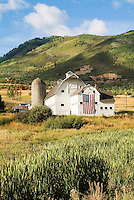 McPolin Barn in summer with large US flag and nice clouds