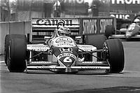 DETROIT, MI - JUNE 22: Nelson Piquet of Brazil drives the Williams FW11/Honda RA166E during the Detroit Grand Prix FIA Formula One World Championship race on the Detroit Street Circuit in Detroit, Michigan, on June 22, 1986.