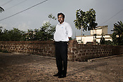 P K Pattanayak, Chief (IR and R&amp;R) TATA Steel Ltd. poses for a portrait in a rehabilitation colony in Kalinganagar, Orissa, India.