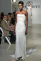 "Model walks runway in a Bridal dress from the Anne Bowen Bridal Spring 2013 ""Coat of Arms"" collection fashion show, during Bridal Fashion Week New York April 2012."