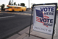 """Apache Junction, Arizona. November 6, 2012 - A bilingual """"Vote Here"""" sign on a sidewalk next to Cactus Canyon Junior High School in Apache Junction, Arizona, in Pinal County (35 miles east of Phoenix), let voters know the school building is serving as a poll place for the Nov. 6 election. Photo by Eduardo Barraza © 2012"""