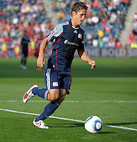 New England midfielder Ryan Guy (13) dribbles toward the Chicago goal.  The Chicago Fire defeated the New England Revolution 3-2 at Toyota Park in Bridgeview, IL on Sept. 25, 2011.