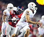 Mississippi defensive end Channing Ward (11) chases Texas'  David Ash (14) at Vaught-Hemingway Stadium in Oxford, Miss. on Saturday, September 15, 2012. (AP Photo/Oxford Eagle, Bruce Newman)