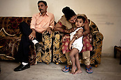 Surrogate mother for first western couple, Rabina Mondal (31) poses for a photograph with her husband, Bishwadeep Mondal and her son, Sahil at her home in Anand, Gujarat, India.
