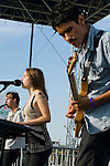 Enjuillet members Taylor Morrow, left, Ela Kitapci and Spencer Collins perform at the Balboa Beach Fest October 13.