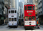 For more than 100 years, electric powered double deck trams of the colonial Hong Kong Tramsway system operate along the bayside of Hong Kong Island, moving residents and tourists with reliable efficiency.