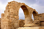 Travel stock photo of Arches under dramatic sky Remains of an ancient building at Roman Agora The Archaeological Site of Kourion near Limassol Roman period in Cyprus Spring 2007 Horizontal