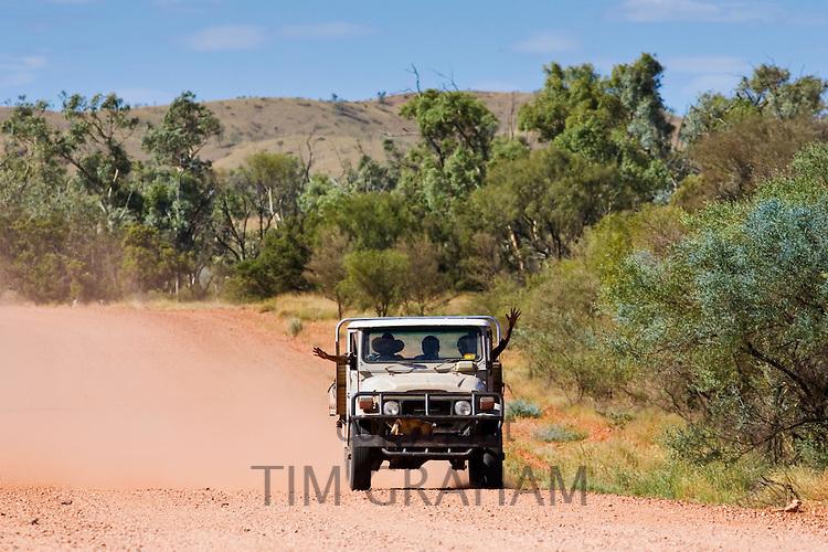 Aborigines in four-wheel-drive vehicle, Mereenie-Watarrka Road, Red Centre, Australia
