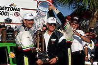 DAYTONA BEACH, FL - FEBRUARY 14: Dale Jarrett (left) and team owner Joe Gibbs (center) are soaked with water in Victory Lane after winning the Daytona 500 NASCAR Winston Cup race at the Daytona International Speedway in Daytona Beach, Florida, on February 14, 1993.