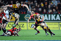 Chiefs Sam Cane is tackled by Crusaders Ben Franks in front of a leaping Brodie Retallick in the Super 15 Rugby semi final match, Waikato Stadium, New Zealand, Friday, July 27, 2012. Credit:SNPA / Ross Setford