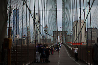 Tourist walk through the Brooklyn Bridge while it remains under maintenance one day before its 130th anniversary in New York,  May 23, 2013, Photo by Eduardo Munoz Alvarez / VIEWpress.