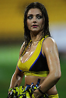 A wet cheerleaders waits for the teams to run out. Super 15 rugby match - Crusaders v Hurricanes at Westpac Stadium, Wellington, New Zealand on Saturday, 18 June 2011. Photo: Dave Lintott / lintottphoto.co.nz