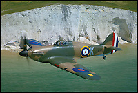 BNPS.co.uk (01202 558833)<br /> Pic: JohnDibbs/Osprey/BNPS<br /> <br /> Hurricane PP3351 a veteran of the Battle of France in 1940 cruises past the White Cliffs of Dover.<br /> <br />  Last of the Few - A photographer's stunning new book is a tribute to the last Hawker Hurricane's - the true workhorse of the Battle of Britain.<br /> <br /> Only 13 WW2 Hurricanes are still airworthy today, compared to over 60 of their more glamorous counterpart the Spitfire.<br /> <br /> But during the Battle of Britain there were in fact twice as many Hurricane's as Spitfires taking on Hitlers Luftwaffe in the skies over southern England.<br /> <br /> The Hurricane may be viewed as less glamorous than the Spitfire, but these stunning photographs reveal just how majestic it was in full flight.<br /> <br /> Photographer John Dibbs has got up close and personal to the legendary fighter planes in order to capture them like never before.<br /> <br /> His 10 year quest for surviving Hurricanes took him all over the world and he photographed them in England, France, the United States and New Zealand.<br /> <br /> Using the skill and experience of highly experienced RAF and civilian pilots, Mr Dibbs was able to fly to within 15ft of some of the last remaining Hurricanes - with breath-taking results.<br /> <br /> There was a fair degree of skill involved as he took the photos from the canopy of a Second World War trainer aircraft which was travelling at 200mph while confronting wind blast.<br /> <br /> The thrilling photos were taken for an a definitive history of the Hurricane which is told by Mr Dibbs and aviation historians Tony Holmes and Gordon Riley in their new book Hurricane, Hawker's Fighter Legend.
