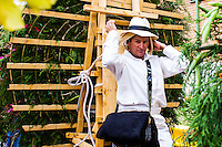 A man carry on his silleta for take part on the 58th Silleteros' parade in the framework of the flowers' fair, this year the silleteros parade was declared intangible heritage of Colombia. Medellín, Colombia 09/08/2015