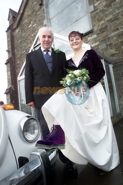 Angela McLeer who got married wearing puprle doc martins in Clogherhead Church pictured before going into the church with her father Nicholas..Picture Paul Mohan Newsfile