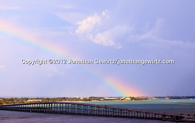 A rainbow appears to originate in the ocean behind Miami Seaquarium, on Virginia Key near Miami, Florida.