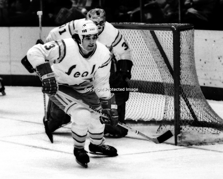 California Golden Seals 1975 action, Mike Christie, and goalie Gary Simmons. (photo by Ron Riesterer)