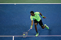 Gael Monfils of France hits a return to Roger Federer of Switzerland during their quarter-final game at the US Open 2014 tennis tournament at the USTA Billie Jean King National Center in New York.  09.04.2014. VIEWpress