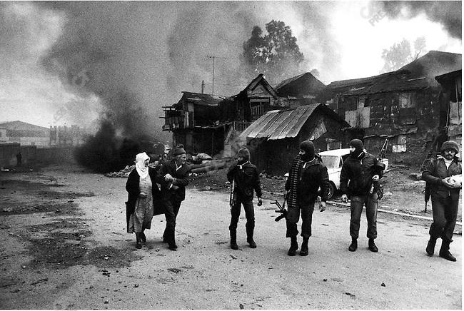 Christian gunmen mocking an elderly  Palestinian couple fleeing, Karantina massacre, Beirut, Lebanon, January 18, 1976