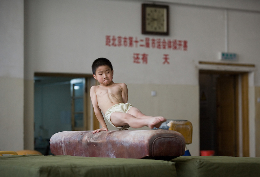 Young gymnasts in training at a sports school in Beijing. Eight year old Zhang Yu.
