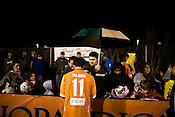 """March 14, 2009. Cary, NC.. The Carolina Railhawks went home in foul weather with a  1-0 victory over the New England Revolution of the MLS, in the inaugural """"Community Shield"""" match and their first professional outing under new coach, Martin Rennie. . Railhawks players signed autographs for fans at the end of the game."""