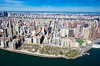 Carl Schurz Park and Yorkville area of upper east side of Manhattan over Hell's Gate and East River.