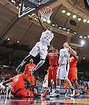Jerian Grant (22) goes up for a shot over Syracuse Orange center Baye Keita (12) in the second half.