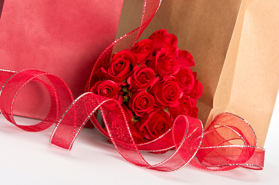 Close up of Saint Valentine Giftbags and rose bouquet