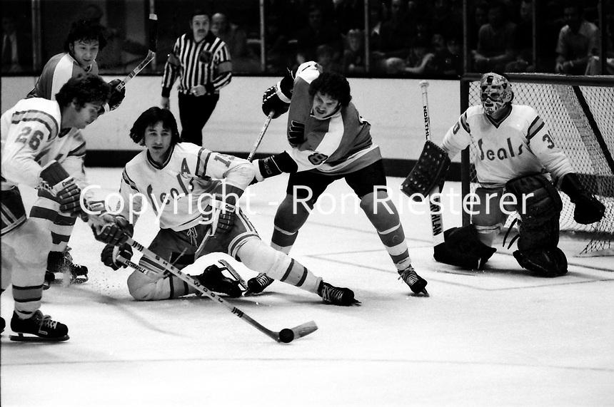 California Golden Seals vs Philadelphia Flyers 1975.<br />Flyer #8 Dave Schultz, Seals #26Bob Girard, #15 Jim Neilson, and golie <br />(photo/Ron Riesterer)