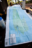 A large map of Isle Royale National Park spread on a table at a backcountry campsite at the park in Michigan USA.
