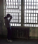 A photographer shoots in the hospital at Alcatraz. A group of photographers from the Media Alliance overnighted on Alcatraz and documented their tour in San Francisco, California.