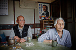 """iitate, May 31 2011 - .Take Takano, 79 , and his wife Sumiko, 82, watching the road 399 from their living room.."""" We retired 2 year ago and we closed our grocer's shop. Before the evacuation, we had a school bus stoppng in front of the shop..We will live in a temporary appartment for 1 or 2 years..We never thought that we would have such a problem before we die..People in the village have always been against the plant, even when they built it. We didn't believe in the government when they said it was safe."""""""