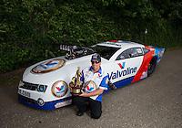 Jun. 2, 2013; Englishtown, NJ, USA: NHRA pro mod driver Mike Janis poses for a portrait after winning the Summer Nationals at Raceway Park. Mandatory Credit: Mark J. Rebilas-