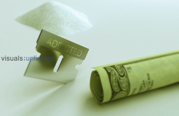 An image of cocaine, a rolled up 20 dollar note and a blade with the word 'addicted' inscribed on it. Royalty Free