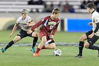 Houston, TX - Friday December 9, 2016: Karsten Hanlin (17) of the Denver Pioneers dribbles the ball around Ian Harkes (16) of the Wake Forest Demon Deacons at the NCAA Men's Soccer Semifinals at BBVA Compass Stadium in Houston Texas.