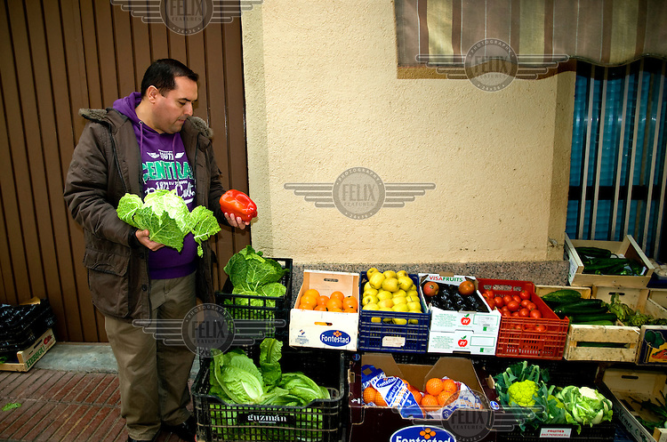A portrait of Alejandro Cao de Benos, photographed in the village of Salomo in northeast Spain buying vegetables at the market. As a Korean-Spanish communist, Alejandro is the president of the Korean Friendship Association (KFA) and has been an advocate of the Democratic People's Republic of Korea (North Korea) since 1990. His Korean name is Zo Sun-il (Korea is One) and he works as an honorary Special Delegate of the DPRK's Committee for Cultural Relations with Foreign Countries - a North Korean government spokesman in Europe.