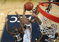 CHARLOTTESVILLE, VA- DECEMBER 6: Mike Scott #23 of the Virginia Cavaliers shoots between Mike Morrison #22 of the George Mason Patriots and Ryan Pearson #24 of the George Mason Patriots during the game on December 6, 2011 at the John Paul Jones Arena in Charlottesville, Virginia. Virginia defeated George Mason 68-48. (Photo by Andrew Shurtleff/Getty Images) *** Local Caption *** Mike Scott;Mike Morrison;Ryan Pearson