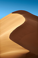 sand being blown on Sahara sand dunes of erg Chebbi, Morocco, Africa